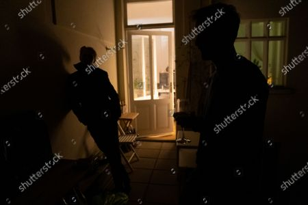 Thomas Smith (L), husband of Susanne Hassler-Smith, and roommates gather for drinks on the balcony of their shared flat in Vienna, Austria, 20 March 2020 (issued 25 March 2020). Susanne Hassler-Smith, 30-year-old Austrian freelance photographer and videographer from Graz, Styria, married Thomas Smith, 34-year-old American video editor and stock trader, on 20 February 2020 in Graz, Austria. Soon after, they had to cancel their honeymoon in Venice, Italy, as the spread of the Covid-19 disease had broken out in Europe. All while in the midst of moving Susanne's home from Graz to Vienna in the month of February, they finished settling in amongst a shared flat in Vienna a week before Covid-19 matters worsened. They had chosen Vienna, which is 'a better place for work and travel than Graz.' Susanne mentions, as a new home base for their plan to commute between Austria and the US before Susanne will apply for an American green card. Thomas' scheduled flight back to Los Angeles was soon canceled, as were many other international flights worldwide due to the global outbreak of the Coronavirus. As a result, Susanne and Thomas have begun applying for VISA extensions for his stay in the European Union to challenge the crises together. Now, they are a part of a shared flat in Austrian capital Vienna, together with roommates from France and Germany, whom the couple didn't know before. Susanne states, 'With everything as it is at the moment, we don't plan too far ahead and take each day as it comes.' In the beginning all roommates followed the news several times a day, but as of day three with the extended restrictions concerning the movement of individuals, they started to relax a bit, accept the new situation and stopped running for every push notification on their phones. Susanne continues, 'We stick to the home office lifestyle and social distancing measures as instructed to help flatten the curve of this epidemic. Since I had planned a lot of video editing work before the loc