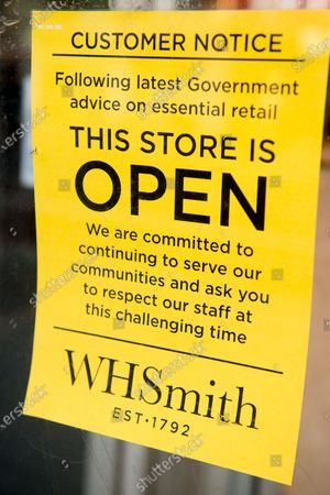Covid-19 Coronavirus London Shutdown - WH Smiths store open sign