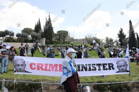 Stock Image of Israeli left wing activists protest in front of the Israeli Knesset in Jerusalem, 25 March 2020. Media reports state that hundreds of Israeli protesters arrived to protest against Prime Minister Benjamin Netanyahu and Knesset Speaker Yuli Edelstein whom they claim are taking advantage of the medical crisis around the SARS-CoV-2 coronavirus which causes the Covid-19 disease to limit the Supreme Court's power and to prevent proper parliamentary procedures in the Knesset.
