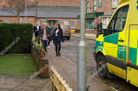 Ep 10042 Monday 30th March 2020  Alya Nazir, as played by Sair Khan, quizzes Geoff Metcalfe about the hotel but he's evasive. Geoff then fakes a funny turn and clutches his chest. Yasmeen Metcalfe calls an ambulance but when the paramedics can find nothing wrong with him, Geoff refuses to go in for tests. Alya and Ryan Connor, as played by Ryan Prescott, are suspicious, especially when Yasmeen announces that Geoff is in no fit state to fly to Spain so she's cancelling their trip. Alya's convinced Geoff faked his heart condition to stop Yasmeen from going to Spain but how can she prove it?