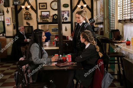 Ep 10046 Wednesday 8th April 2020 Kelly Neelan, as played by Millie Gibson, approaches Asha Alahan, as played by Tanisha Gorey, and Summer Spellman, as played by Matilda Freeman, in the cafe and explains that she's just started at Weatherfield High. Gary Windass clocks Kelly in her new school uniform.