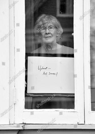 Artist Shirley Fuerst poses for a portrait series by Shutterstock Staff Photographer, Stephen Lovekin, shot around the Ditmas Park neighborhood of Brooklyn, New York.