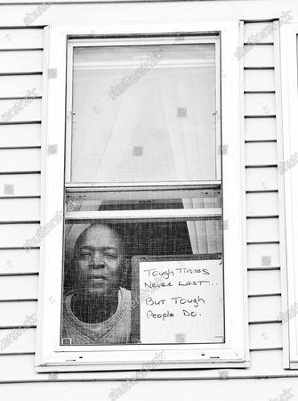 Robert E. Clark Jr. poses for a portrait series by Shutterstock Staff Photographer, Stephen Lovekin, shot around the Ditmas Park neighborhood of Brooklyn, New York.