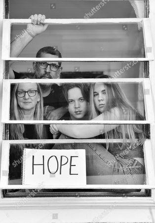 Agnetha Septimus, Matthew Septimus, and children Ezra and Nora, pose for a portrait series by Shutterstock Staff Photographer, Stephen Lovekin, shot around the Ditmas Park neighborhood of Brooklyn, New York.