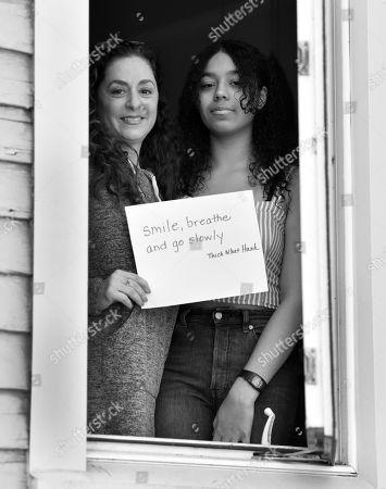 Adrienne Merjian and daughter Sophia pose for a portrait series by Shutterstock Staff Photographer, Stephen Lovekin, shot around the Ditmas Park neighborhood of Brooklyn, New York.