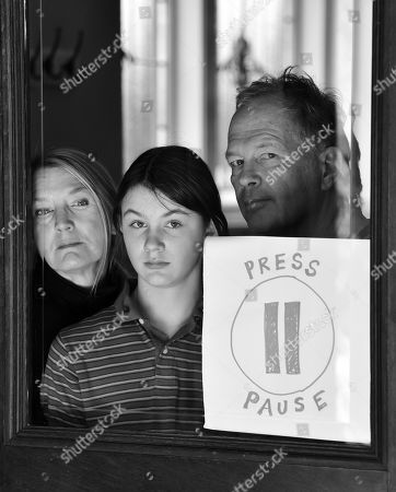 Stock Photo of Amanda Kavanagh, James Dougal, and daughter Oonagh pose for a portrait series by Shutterstock Staff Photographer, Stephen Lovekin, shot around the Ditmas Park neighborhood of Brooklyn, New York.