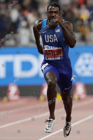 Stock Image of Justin Gatlin, of the United States, competes enroute to a silver medal in the 100m event at the World Athletics Championships in Doha, Qatar. Gatlin will be 39 by the time the games roll around, and Jamaican Asafa Powell is just nine months younger. They are both ancient in this young sprinter's game. They still think they can give the younger generation a run for their money
