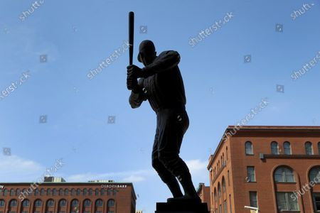 Stock Photo of Statue of Major League Baseball Hall of Fame member Stan Musial stands outside Busch Stadium, home of the St. Louis Cardinals baseball team, in St. Louis. The start of the regular season, which was set to start on Thursday, is on hold indefinitely because of the coronavirus pandemic