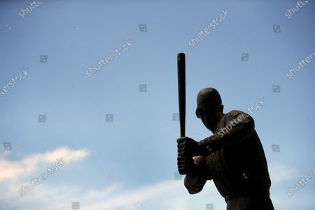 Stock Picture of Statue of Major League Baseball hall of fame member Stan Musial stands outside Busch Stadium, home of the St. Louis Cardinals baseball team, in St. Louis. The start of the regular season, which was set to start on Thursday, is on hold indefinitely because of the coronavirus pandemic