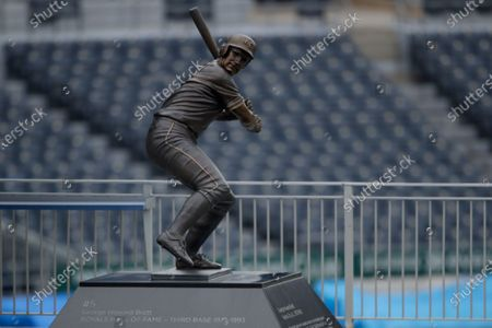 Statue of Major League Baseball Hall of Fame member George Brett stands against empty seats at Kauffman Stadium, home of the Kansas City Royals baseball team, in Kansas City, Mo. The start of the regular season, which was set to start on Thursday, is on hold indefinitely because of the coronavirus pandemic