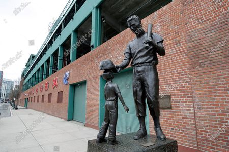 Stock Photo of Statue of former Boston Red Sox baseball player Ted Williams, right, stands outside Fenway Park, in Boston. There will be empty ballparks on what was supposed to be Major League Baseball's opening day, with the start of the Major League Baseball regular season indefinitely on hold because of the coronavirus pandemic