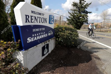 Sign for the Seattle Seahawks' NFL football practice facility and headquarters stands, in Renton, Wash. NFL Commissioner Roger Goodell has instructed all 32 teams to close their facilities to all but a select few employees as a safeguard against the new coronavirus