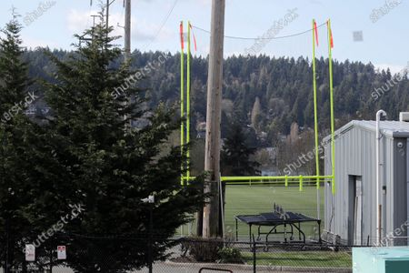 Stock Picture of Goal posts and other training equipment sit idle at the Seattle Seahawks' NFL football practice facility and headquarters, in Renton, Wash. NFL Commissioner Roger Goodell has instructed all 32 teams to close their facilities to all but a select few employees as a safeguard against the new coronavirus. AP Photo/Ted S. Warren