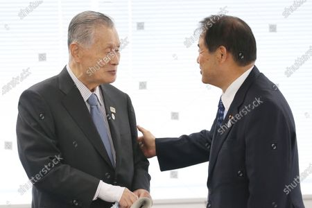 "Tokyo 2020 Organizing Committee President Yoshiro Mori, left, talks with Vice President Toshiaki Endo during the first meeting of the ""Tokyo 2020 New Launch Task Force"" in Tokyo, two days after the unprecedented postponement was announced due to the spreading coronavirus"