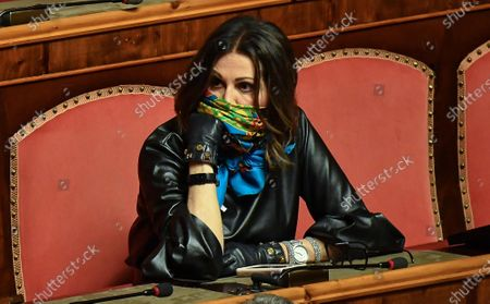 Italian senator Daniela Santanche, using a scarf as an improvised protective mask, during a report of Italian Prime Minister Giuseppe Conte (unseen) at the Italian Senat about the measures taken to counter the spread of the Coronavirus Covid19 pandemic in Italy, Rome, Italy, 26 March 2020. Countries around the world are taking increased measures to stem the widespread of the SARS-CoV-2 coronavirus which causes the Covid-19 disease.