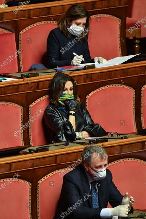 Italian senator Daniela Santanche (C), using a scarf as an improvised protective mask, during a report of Italian Prime Minister Giuseppe Conte (unseen) at the Italian Senat about the measures taken to counter the spread of the Coronavirus Covid19 pandemic in Italy, Rome, Italy, 26 March 2020. Countries around the world are taking increased measures to stem the widespread of the SARS-CoV-2 coronavirus which causes the Covid-19 disease.