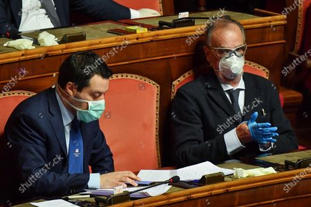 Italian Senator and leader of the Lega Nord party Matteo Salvini (L) and Senator Roberto Calderoli (R) attend a session of Italian Senate about the report of Italian Prime Minister Giuseppe Conte (unseen) on measures taken to counter the spread of the Coronavirus Covid19 pandemic in Italy, Rome, Italy, 26 March 2020. Countries around the world are taking increased measures to stem the widespread of the SARS-CoV-2 coronavirus which causes the Covid-19 disease.
