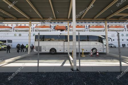 A bus waiting for passengers from MSC Fantasia cruise ship during the corona virus pandemic, Lisbon