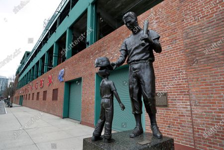 Stock Picture of Statue of former Boston Red Sox baseball player Ted Williams, right, stands outside Fenway Park, in Boston