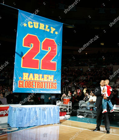 Harlem Globetrotters basketball legend Curly Neal looks on with his grandson Jaden Neal-Roberts as his No. 22 is retired by the world renowned Harlem Globetrotters at Madison Square Garden