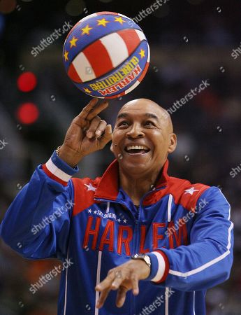 Curly Neal, of the Harlem Globetrotters, performs during a timeout in the second quarter in the game between the Indiana Pacers and the Phoenix Suns of their NBA basketball game