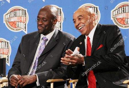 Hall of Fame basketball players Curly Neal, right, and Special K Daley share a light moment during a news conference announcing the 2010 Hall of Fame nominees at the NBA All Star weekend