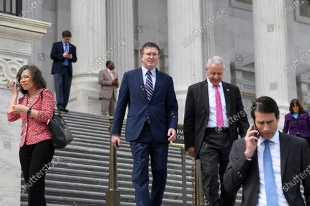 Rep. Thomas Massie, R-Ky., center, walks with Rep. Ken Buck, R-Colo., pink tie, as they leave Capitol Hill in Washington, after attempting to slow action on a rescue package. Despite Massie's effort, the House, acting with exceptional resolve in an extraordinary time, rushed President Donald Trump a $2.2 trillion rescue package Friday, tossing a life preserver to a U.S. economy and health care system left flailing by the coronavirus pandemic