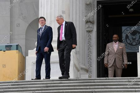 Rep. Thomas Massie, R-Ky., left, and Rep. Ken Buck, R-Colo., center, leave Capitol Hill in Washington, . Massie attempted to slow action on a rescue package. Despite his effort, the House, acting with exceptional resolve in an extraordinary time, rushed President Donald Trump a $2.2 trillion rescue package, tossing a life preserver to a U.S. economy and health care system left flailing by the coronavirus pandemic