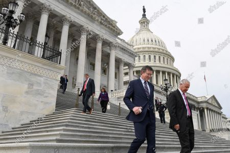 Rep. Thomas Massie, R-Ky., left, and Rep. Ken Buck, R-Colo., right, leave Capitol Hill in Washington, . Massie attempted to slow action on a rescue package. Despite his effort, the House, acting with exceptional resolve in an extraordinary time, rushed President Donald Trump a $2.2 trillion rescue package Friday, tossing a life preserver to a U.S. economy and health care system left flailing by the coronavirus pandemic