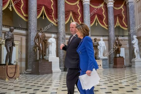 Democratic Speaker of the House Nancy Pelosi (R) speaks Democratic Representative from Michigan Dan Kildee (L) in Statuary Hall as the US House of Representatives debates the Coronavirus Aid, Relief, and Economic Security Act (CARES Act) at Capitol Hill in Washington, DC, USA, 27 March 2020. The Senate passed the CARES Act, a coronavirus COVID-19 stimulus package worth more than two trillion US dollars.