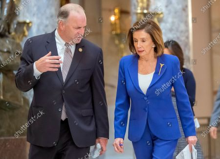 Democratic Speaker of the House Nancy Pelosi (R) speaks with Democratic Representative from Michigan Dan Kildee (L) in Statuary Hall as the US House of Representatives debates the Coronavirus Aid, Relief, and Economic Security Act (CARES Act) at Capitol Hill in Washington, DC, USA, 27 March 2020. The Senate passed the CARES Act, a coronavirus COVID-19 stimulus package worth more than two trillion US dollars.