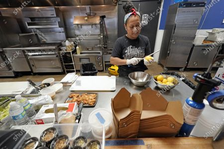 Stock Picture of Anabel Medina makes lemon bacon cookies at Georgia James restaurant, one of four restaurants owned by Houston chef Chris Shepherd, in Houston. Local officials have limited restaurants to takeout and delivery, a business environment that has become the temporary new normal for most eateries across the U.S. during the coronavirus outbreak