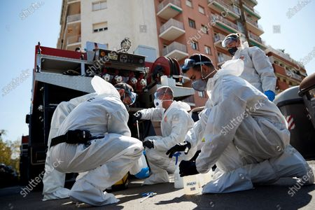 Members of the Spanish Army's Military Emergency Unit (UME) work on the disinfection of DIDA juvenile center in Barcelona, Catalonia, Spain, 28 March 2020. Spain faces the 14th consecutive day of national lockdown in an effort to slow down the spread of the pandemic COVID-19 disease caused by the SARS-CoV-2 coronavirus.