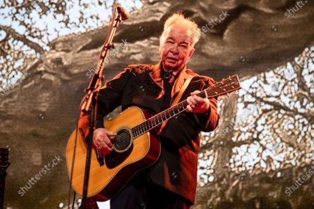 """John Prine performing at the Bonnaroo Music and Arts Festival in Manchester, Tenn. The family of John Prine says the singer-songwriter is critically ill and has been placed on a ventilator while being treated for COVID-19-type symptoms. A message posted on Prine's Twitter page said the """"Angel from Montgomery"""" singer has been hospitalized since Thursday and his condition worsened on Saturday"""