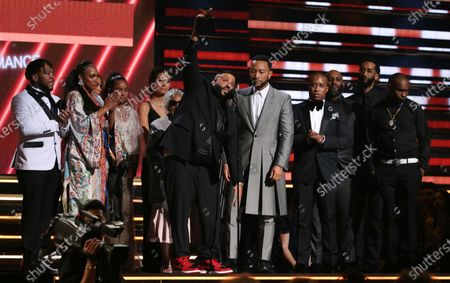 Khaled, center left, and John Legend, center right, and members of Nipsey Hussle's family accepting the award for best rap/sung performance at the 62nd annual Grammy Awards in Los Angeles. Hussle, 33, was shot and killed outside his Los Angeles clothing store on March 31, 2019. A year after Hussle's death, his popularity and influence are as strong as ever. He won two posthumous Grammys in January, he remains a favorite of his hip-hop peers and his death has reshaped his hometown of Los Angeles in some unexpected ways