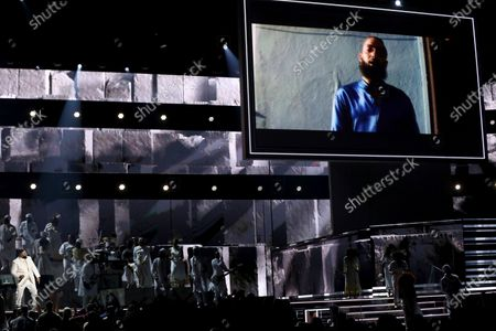 Khaled, left, performing a tribute honoring the late rapper Nipsey Hussle at the 62nd annual Grammy Awards in Los Angeles. A year after Hussle's death, his popularity and influence are as strong as ever. He won two posthumous Grammys in January, he remains a favorite of his hip-hop peers and his death has reshaped his hometown of Los Angeles in some unexpected ways