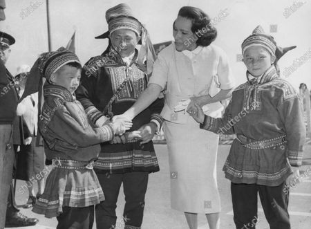 American screen actress Dolores del Rio congratulates actor Anders Pentha, centre, and his two sons, also actors, after the showing of their Norwegian film Same Jakki at the International Film Festival in Cannes