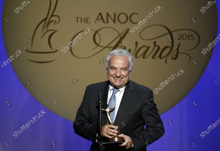 "In this filer, Francesco Ricci Bitti speaks after receiving the award for Outstanding Lifetime Achievement, during an Association of National Olympic Committees (ANOC) awards ceremony, in Washington. Despite some early differences of opinion, the 33 sports that make up the Olympic program voted unanimously on Monday to delay the Tokyo Games by a full year. Moments later, the International Olympic committee made it official. ""We were the last to express our view. We're the ones who have problems with the calendar to deal with,"" said Francesco Ricci Bitti, the president of the Association of Summer Olympic International Federations (ASOIF"