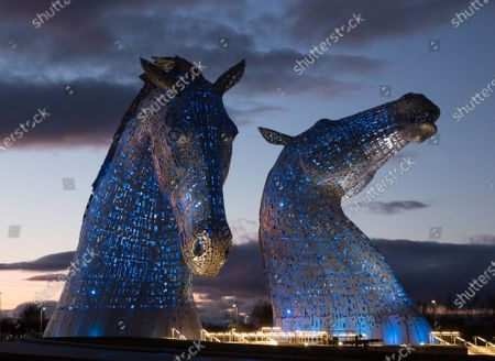 The Kelpies in Falkirk are lit up in blue as a tribute to honor the National Health System (NHS) and care-workers, in Falkirk, Scotland, 30 March 2020. According to news reports, the 30-meters high horse sculptures will be illuminated in blue for the whole period of the COVID-19 crisis as a lasting tribute to NHS and social care workers, after the 26 March evening's show of national support which saw residents across the United Kingdom applauding in support of health workers. The sculptures, created by artist Andy Scott, were erected in 2014 at the Helix Park near an extension of the Forth and Clyde Canal.