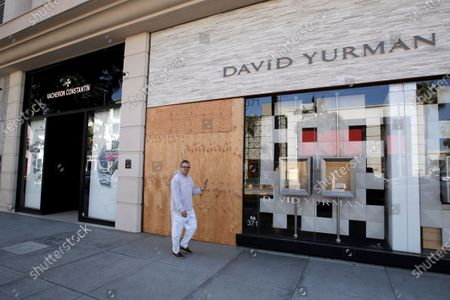 Stock Photo of The entrance to the David Yurman store is boarded up on Rodeo Drive, in Beverly Hills, Calif. Over the weekend, more people appeared to heed the message to stay home after beaches and many parks were closed by state and local officials following a swarm of visitors during the first weekend of the state's stay-at-home order in reaction to the coronavirus pandemic