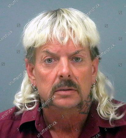 """Provided by the Santa Rosa County Jail in Milton, Fla., shows Joseph Maldonado-Passage, also known as """"Joe Exotic."""" Maldonado-Passage was convicted in an unsuccessful murder-for-hire plot against Carole Baskin, the founder of Big Cat Rescue, who he has repeatedly accused of killing her husband Jack """"Don"""" Lewis. Lewis' unsolved 1997 disappearance and Maldonado-Passage's accusations are the subject of new Netflix series """"Tiger King"""