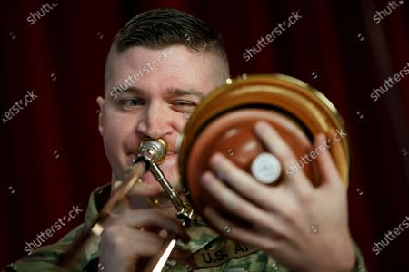 """Stock Image of Army Field Band member Staff Sgt. Kyle Johnson, originally form College Station, Texas, plays the trombone during rehearsal of their daily """"We Stand Ready"""" virtual concert series at Fort George G. Meade in Fort Meade, Md., . The Army Field Band's mission is to bring the military's story to the American people. And they're not letting the coronavirus get in the way"""