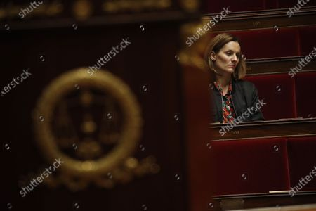 Stock Image of Member of Parliament Elsa Faucillon of the GDR leftist group attends the weekly session of questions to the government at the National Assembly in Paris, France, 31 March 2020. Philippe announced that the confinement extends until April 15, 2020. France now has 44,550 coronavirus cases, 3,024 deaths and 7,927 recovered.