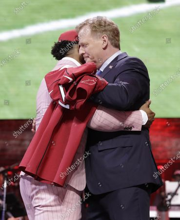 "Oklahoma quarterback Kyler Murray embraces NFL Commissioner Roger Goodell after the Arizona Cardinals selected Murray in the first round at the NFL football draft in Nashville, Tenn. NFL vice president Troy Vincent has sent a letter to several prospects inviting them to participate ""live"" in the NFL draft in three weeks. In recent drafts, first-round selections were announced by Commissioner Goodell. Then followed hugs involving players and Goodell - some of them comical - and photo sessions with the players wearing team ball caps or even showing off team jerseys. This year, with all public events at the planned site of Las Vegas canceled and the draft set to proceed remotely, players will likely be at their homes when their names are called"