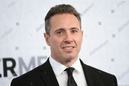 News anchor Chris Cuomo at the WarnerMedia Upfront in New York. Cuomo has announced that he has tested positive for the coronavirus. The prime-time host is one of the most visible media figures to come down with the disease. He said he's experienced chills, fever and shortness of breath. He promised to continue doing his show while in quarantine in the basement of his home