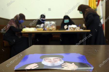 Women supporters of Hezbollah collect donations for needy people as seen a picture of the Hezbollah leader Hassan Nasrallah during a tour done by Hezbollah to show their preparation to fight the coronavirus in the southern suburb of Beirut, Lebanon, 31 March 2020. According to the Lebanese health ministry, there are 463 registered cases of the COVID-19 disease caused by the SARS-CoV-2 coronavirus in the country as of 31 March 2020; twelve patients died, while 37 recovered. The curfew from 7:00 pm until 5:00 am local time was announced by authorities on 26 March 2020.