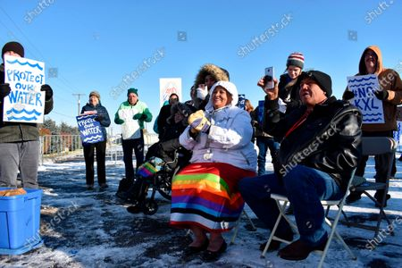 Opponents of the Keystone XL oil pipeline from Canada demonstrate in sub-freezing temperatures in Billings, Mont. Alberta is investing $1.1 billion in the disputed Keystone XL pipeline, a project that Alberta Premier Jason Kenney says is crucial for the province's economy