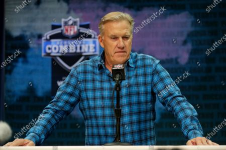 """Denver Broncos general manager John Elway speaks during a news conference at the NFL football scouting combine in Indianapolis. NFL teams are having to rely more heavily on game film of college prospects as they prepare for the draft at a time when the COVID-19 pandemic has halted business as usual. On Elway said in a conference call, """"We'll just have to conclude the best we can from what we can see on the tape"""