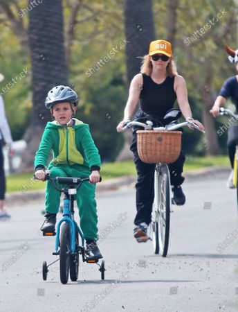 Reese Witherspoon and Tennessee Toth ride bikes in Los Angeles.