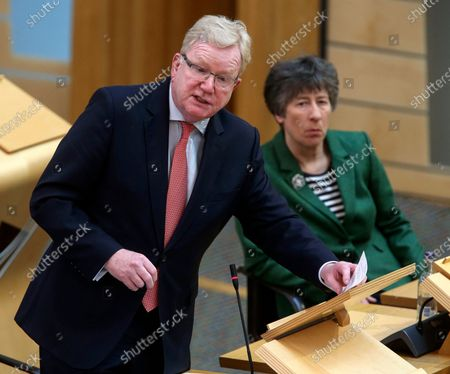 Stock Picture of Jackson Carlaw (L) MSP, Scottish Conservative Leader speaks during a Scottish Parliament session at Holyrood for the First Miâ€nister's statement on the coronavirus pandemic, in Edinburgh, Scotland, Britain, 01 April 2020. Countries around the world implemented measures to stem the widespread of the SARS-CoV-2 coronavirus that causes the COVID-19 disease.